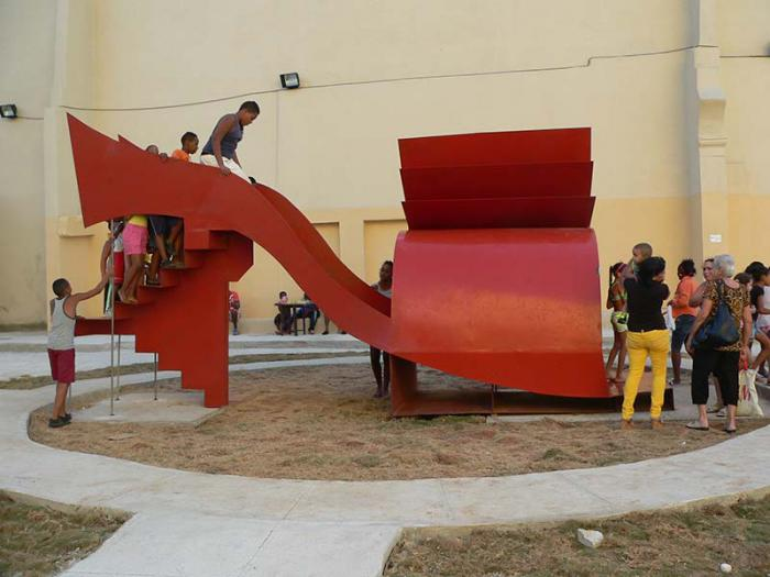 Liudmila López (Cuba) turns a giant sculpture of a woman's shoe into an interactive slide, in her work Parto a la libertad.