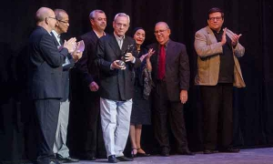 Visibly moved, Havana City Historian Eusebio Leal, (pictured holding the award) received the Alicia Alonso Grand Theater of Havana Annual Prize, for his important work as a historian, extraordinary efforts to restore Old Havana, for his merits as an educa