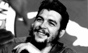 Che participating in a meeting of exemplary workers at the Habana Libre Hotel.