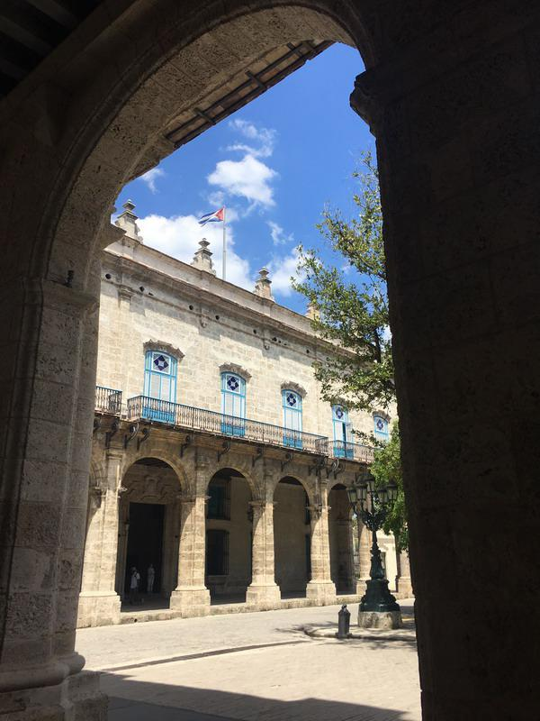 The majestic facade of countless arches of the Palacio de los Capitanes Generales.